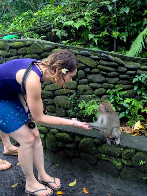 Carrie holding a monkey's hand